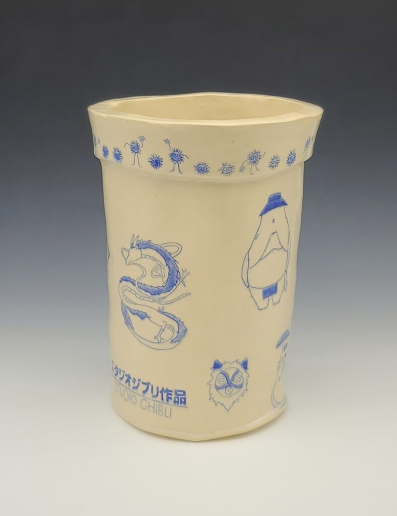 vase with blue images