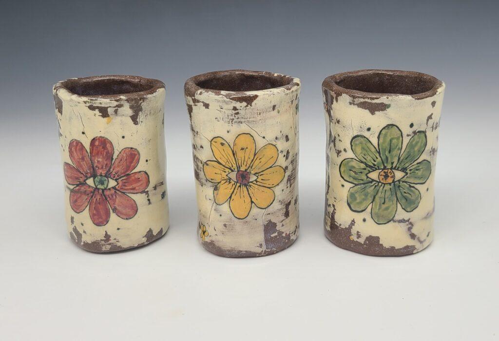 three flower mugs