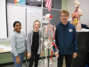 Picture of students with skeleton