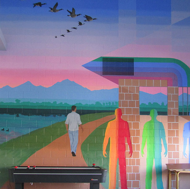 Wall mural painted by students as a project with a visiting artist - depicts an individual walking a path artound Decker Lake