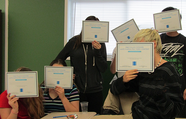 Students at the classroom in Salt Lake County Youth Services show off certificates of participation