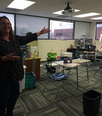 Jill, teacher, showing off her new classroom at AIM