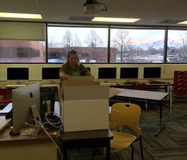 Sandy, teacher, unpacking her new classroom at AIM
