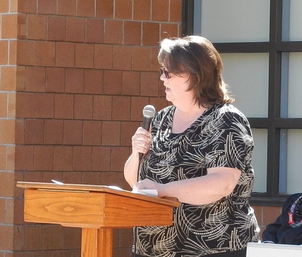 Angie speaking at Decker Lake Youth Center graduation
