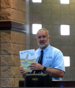 Jason Rosvall speaking at graduation